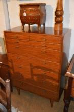 A Lebetkin Bros retro bedroom suite comprising dressing table, chest of drawers and bedside cupboard.
