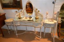 A 1950s gessoed Louis XVI style dressing table with caned back, together with a pair of matching oval bedside tables