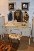 A 1950s white painted dressing table on cabriole legs, together with a cheval mirror, an upholstered stool and a painted wrought iron lamp