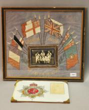*A framed naval flag embroidery with photograph of sailors to centre