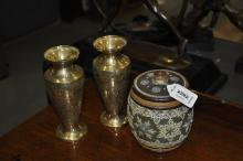 A Doulton's Slater's patent tobacco jar, 13cm high, and a pair of Indian brass vases