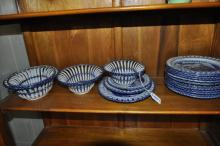 A quantity of basketware porcelain comprising four oval baskets, the largest 22.5cm, three oval stands and twelve circular plates with pierced rims, each with willow pattern decoration.