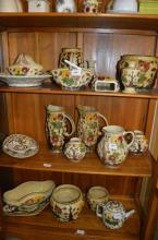 A quantity of woods Indian Tree pattern wares including a teapot, wall pocket jugs, cache-pots, vases, etc (20)