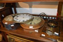 Two circular wall clocks for spares or repair, a further dial, and a servant's bell