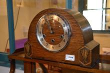 An oak mantle clock