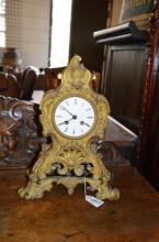 A 19th century gilt brass mantel clock, white enamel dial with Roman numerals