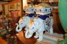 A pair of jardinieres modelled as elephants with howdahs, 35cm tall.