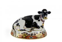 Two Royal Crown Derby cow paperweights with gold stoppers: 'Daisy Cow', 15cm high, together with 'Friesian Cow Buttercup', 17cm wide