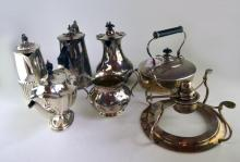 An Arts and Crafts plated kettle on stand, a plated teapot, a plated tea service, a plated half fluted hot water jug and other silver plated items