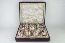 A set of six Royal Crown Derby coffee cups and saucers in the Japan pattern, cased