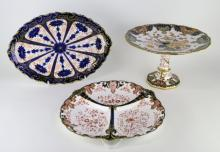 A Royal Crown Derby; Japan pattern comport, 25cm diameter; an hors d'oeuvre dish; an oval dish decorated in imari colours, c1897, 33cm long (3)