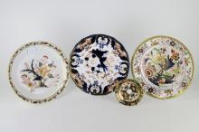 Three Crown Derby plates in various imari colour patterns, the largest 22cm and a crown Derby saucer dish in imari palette, 9.5cm (4)