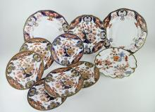 A set of six Royal Crown Derby tea plates in imari colours, 17.5cm, a pair of dinner plates, 26cm; a smaller plate, 23cm; and a further plate with fluted rim, 22cm (10)