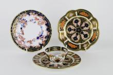 A Royal Crown Derby dish with fluted rim; a similar small plate; a Derby tea bowl with Stevenson and Hancock mark and one further plate (4)