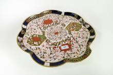 A Royal Crown Derby comport with fluted rim, decorated in imari colours, 42cm diameter