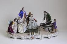 An exceptionally large Sitzendorf porcelain group of Mozart and his father entertaining Marie Antoinette and her attendants, approximately 59cm wide