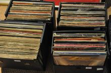 A large collection of vinyl LPs in four cases, various artists.