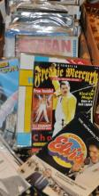 Various artists - a collection of rock and pop souvenier magazines including Elvis Presley and Queen with rock and punk magazines and other books and a Graham Norton signed VHS