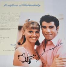 *Grease - signed photo of John Travolta and Olivia Newton-John, with certificate (Lot subject to VAT)