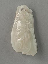 A WHITE JADE CARVING OF BEANS PENDANT