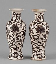 A PAIR OF MOLDED BROWN- GLAZED VASES