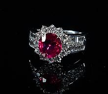 A 18K WHITE GOLD RUBY AND DIAMOND RING