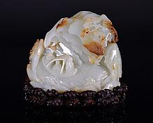 A WHITE AND RUSSET JADE BOULDER