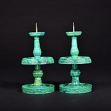 A PAIR OF  CARVED TURQUOISE CANDLESTICKS