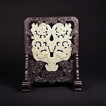 A CARVED WHITE JADE AND WOOD DRAGON SCREEN
