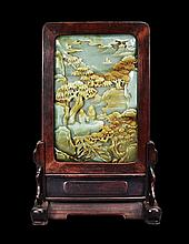 A CELADON JADE 'LANDSCAPE AND FIGURE' SCREEN