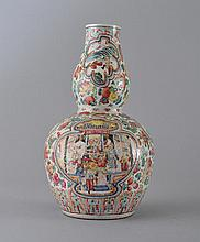 A FAMILLE-ROSE DOUBLE-GOURD 'FIGURE' VASE