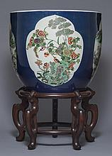 A BLUE-GROUND WUCAI JAR AND STAND
