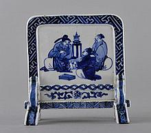 A BLUE AND WHITE 'FIGURE' TABLE SCREEN