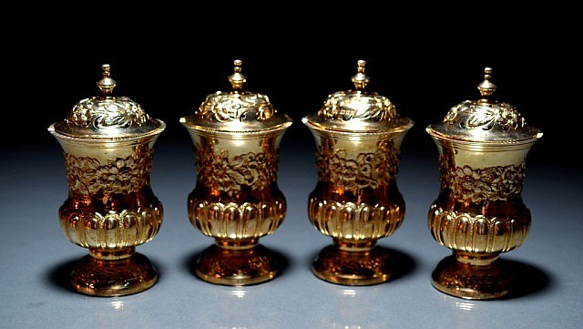 SET OF FOUR EDWARDIAN SILVER GILT CASTERS