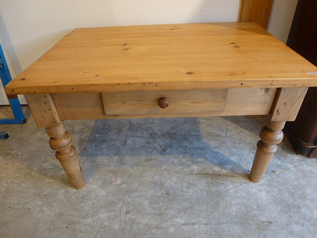 A waxed pine coffee table with frieze drawer
