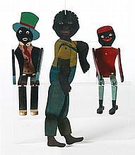 Three black dancing dolls