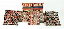 Seven Oriental rug pillows