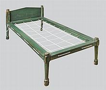 Green bed w/four booted legs w/castors