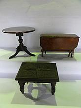 An antique miniature mahogany model of a Georgian occasional table with circular