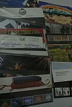 A box containing a large quantity of Royal Mail Mint Stamps in presentation pack