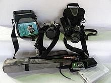 A Canon EOS 500N camera, a Fuji Finepix S9500 camera (both in bags), a Canon IXU