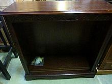 A Jaycee reproduction oak dwarf freestanding open bookcase with carved foliate f