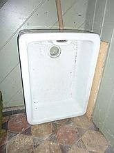 A white glazed ceramic butlers sink
