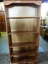A modern pine freestanding open bookcase with four adjustable shelves
