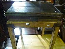 A rustic antique oak writing slope with hinged lid and simply fitted interior ra