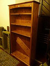 A modern stripped pine freestanding open bookcase with four adjustable shelves,