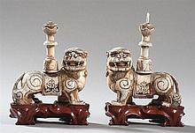 PAIR OF LIONS AS CANDLE HOLDERS