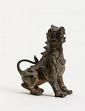 A BRONZE LION FIGURE WITH GREENGREY PATINA