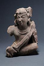 FRAGMENT OF A DEITY WITH A COMPLETE HEAD