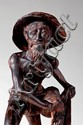 A CHARCTERFUL WOOD CARVING OF A FISHERMAN WITH A FISHNET